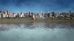 Long shot of city by the water Stock Footage
