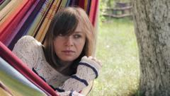 Stock Video Footage of Girl in hammock gazing in the distance