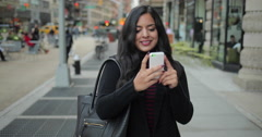 Young Indian woman in city texting cell phone Stock Footage