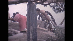Vintage 16mm film, 1970, India, Delhi, hand operated mill Stock Footage