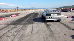 Sport car drag challenge at race track Stock Footage