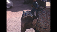 Vintage 16mm film, 1970, India, Delhi, riding an elephant - stock footage