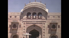 Vintage 16mm film, 1970, India, Delhi, gate of temple Stock Footage
