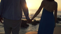 Couple admire view on beach and holding hands, super slow motion 240fps - stock footage