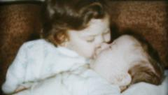 Cute Little Girl Kisses Baby Brother-1959 Vintage 8mm film Stock Footage