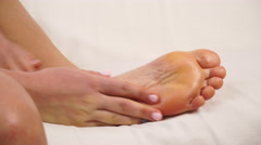 Woman taking care of her dry skin foot applying cream. 4K Stock Footage