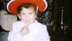 Little Christmas Cowboy Girl Points At Camera-1959 Vintage 8mm film Stock Footage