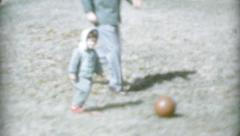 Little Girl Playing Soccer With Her Dad-1959 Vintage 8mm film - stock footage
