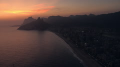 Flying along Ipanema Beach at Dusk in Rio de Janeiro Stock Footage
