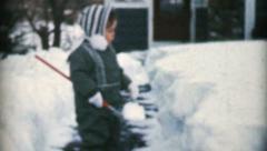 Cute Little Girl Shovelling Snow-1959 Vintage 8mm film Stock Footage