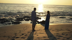 Young couple breaking up on beach and walking away, super slow motion 240fps Stock Footage