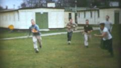 University Aged Men Playing Pick Up Football-1950 Vintage 8mm film Stock Footage