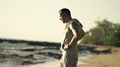 Young male jogger enjoying view on beach, super slow motion 240fps  Stock Footage