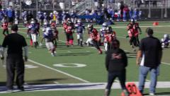 2713 - youth football, PeeWee, Pop Warner, run up left side for 25, hard tackle. - stock footage