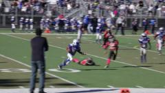 2716 - youth football, PeeWee, Pop Warner, stiff arm, hard hit out of bounds Stock Footage