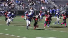 2718 - youth football, PeeWee, Pop Warner, stiff arm, lost a yard, tough defense Stock Footage