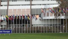 Team arranging all European Union Flags at half-mast Stock Footage