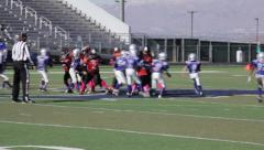 2717 - youth football, PeeWee, Pop Warner, hard run up the middle, gang tackle - stock footage