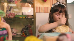 Little girl with an awl to poke crafts. Stock Footage