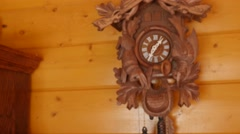 A beautiful hand carved cuckoo clock on a wall Stock Footage