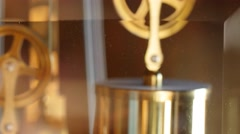 A closeup dolly shot of the pendulum on a grandfather clock Stock Footage