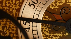 A closeup dolly shot of the second hand on a grandfather clock Stock Footage