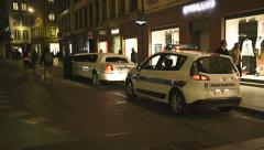 Police officers inspecting a limousine Stock Footage