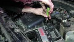 Oil Change mechanic screwdriver unscrews the screws on the cover Stock Footage