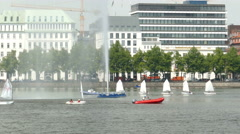 4K UHD Hamburg river Alster Children Kids learning windsurfing on water Stock Footage