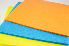 Sponge scouring pads on an isolated white background - stock photo
