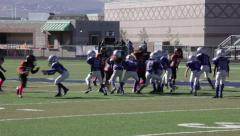 2724 - youth football, PeeWee, Pop Warner, run up the middle, nice tackle - stock footage