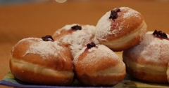 Pan across a plate of Hanukkah Donuts Stock Footage