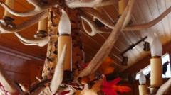 Beautiful hand carved deer antler chandelier Stock Footage