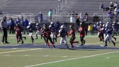 2722 - youth football, PeeWee, Pop Warner, hard tackle out of bounds - stock footage