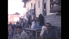 Vintage 16mm film, 1970, India, crowded market food prep Stock Footage