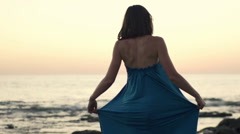 Young, happy woman turning around on beach, super slow motion 240fps Stock Footage