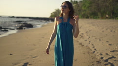 Young, happy woman walking on beach, super slow motion 240fps - stock footage