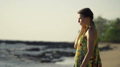 Sad, pensive woman standing on beach, super slow motion 240fps  - stock footage