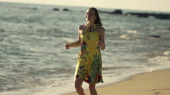 Young, happy woman running on beach, super slow motion 240fps Stock Footage