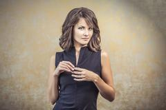 Portrait of a woman in a black tight dress with hair and makeup Stock Photos