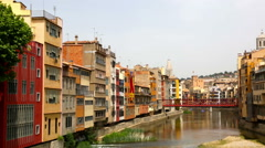 Day view of river and picturesque homes in Girona. Catalonia, Spain Stock Footage
