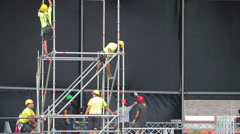 Worker set up the stage for the live music event Stock Footage