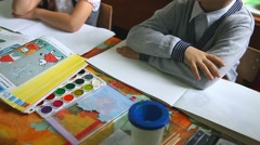 Stock Video Footage of children in the class draw paints in an album drawing lesson School