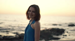 Portrait of pretty, happy woman during sunset on beach Stock Footage