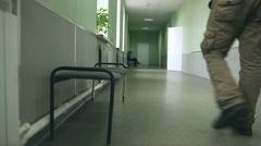 Man student walks down the hallway back University Stock Footage