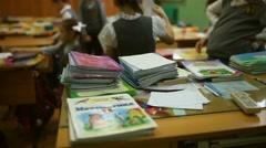 Teacher's desk are notebooks change children run class school Stock Footage