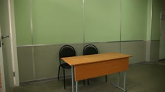Class school desk chairs interior camera left rolling Stock Footage