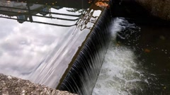 The waterfall on the creek in city Stock Footage