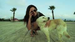 Girl with dog on quay Stock Footage