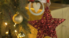 Christmas tree decorations big red star Stock Footage